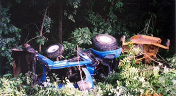 Photo of an accident scene involving a tractor overturn
